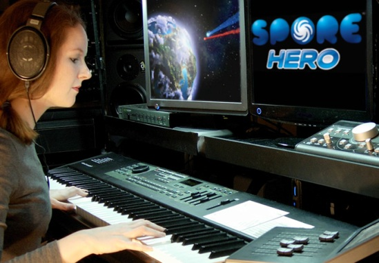 This photo includes video game composer Winifred Phillips working in the Generations Productions music studio. Phillips' credits feature entries in such popular and famous game franchises as Assassin's Creed Liberation, God of War, LittleBigPlanet, The Sims, and Total War.