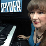 Photo of video game composer Winifred Phillips working in her music production studio on the music of the Apple Arcade game Spyder. Phillips is a frequent writer and speaker on the role of music in games, with multiple lectures given at such venues as the Game Developers Conference (GDC).