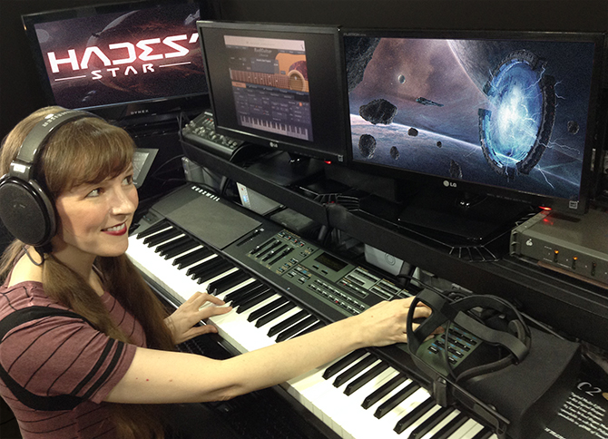 Working on the music of the Hades' Star video game, video game composer Winifred Phillips is here pictured in her music studio at Generations Productions.