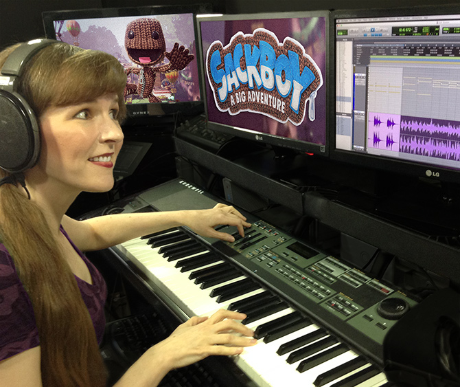 This photo depicts game music composer Winifred Phillips working in her music production studio at Generations Productions LLC on the musical score of the Sackboy: A Big Adventure game from Sumo Digital. Winifred Phillips is an award-winning video game music composer whose credits include games from five of the biggest franchises in gaming (Assassin's Creed, God of War, Total War, LittleBigPlanet, The Sims).